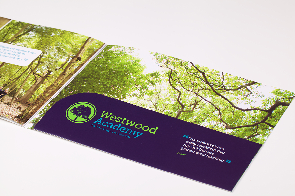 An image of the Westwood Academy brochure folded out on a table